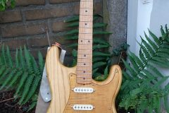 Lightweight Swamp Ash strat with flame maple pickguard and tremolo cover.